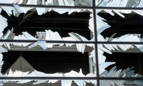Windows at Brussels Airport after suicide bombings on Tuesday. Credit Pool photo by Frederic Sierakowski